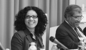 Mona Eltahawy and Khalil Shikaki seated behind microphones at a panelists' table.
