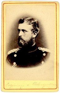 Leopold von Hohenzollern wearing a uniform, looking to the side. Cursive writing is barely legible at the bottom of the card.