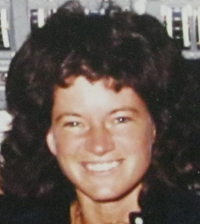 Close-up of Sally Ride's mission photo from the group photo presented to Jean Mayer