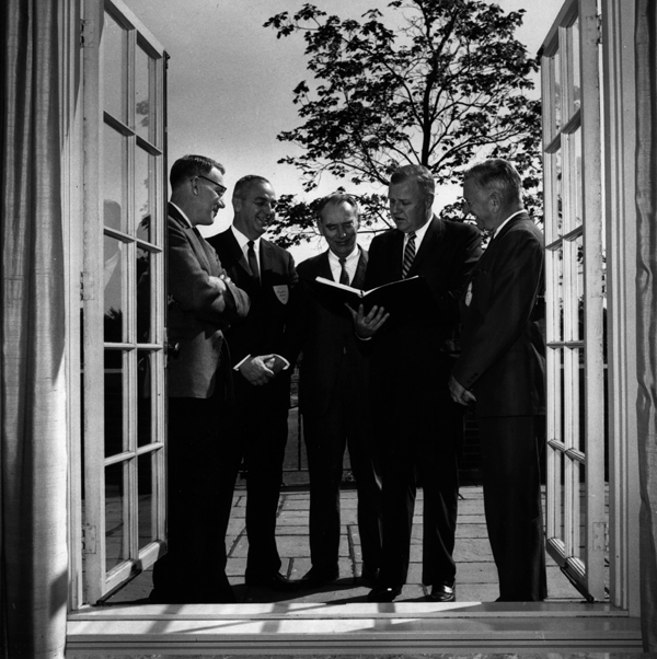 Acting president Leonard Chapin Mead, Tufts administrators John C. Palmer, Frank A. Tredinnick, with two other members of Tufts adminstration, 1966
