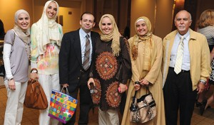 Lena Elbadawi, a graduate of the periodontology certificate program, with her family at the postgraduate ceremony in Boston on June 9.