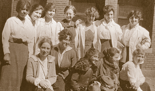 women students from the dental and medical schools in 1917, with Erna Neumann front row, far left;  below right, Neumann at Commencement, June 17, 1918.