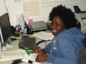 Keli Young processes new course proposals - with a smile!