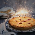 Pie with sparklers lit on top