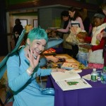 Dressed as the Blue Fairy, Ame Dyckman, author of Boy + Bot, signed copies of her book.