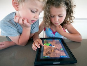 children-on-ipad-alamy