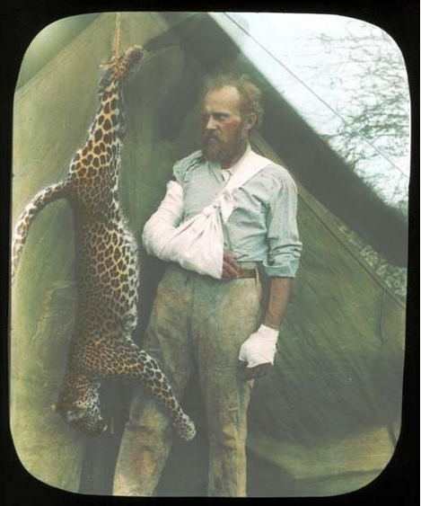 Carl Akeley, museum hero and innovator, posing with a leopard he took down bare-handed. Photo from the American Museum of Natural History.