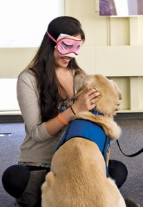 A blindfolded Emily Zhang, A16, gets to know Norm. Photo: Alonso Nichols.