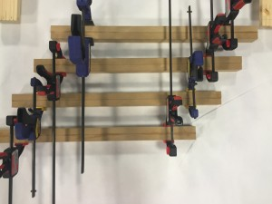MDF legs clamped down while drying