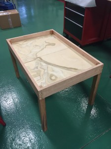 Coffee table with the base layer of the model in place