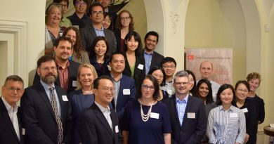 Group photo of CIERP staff and affiliates posing on a staircase at BU