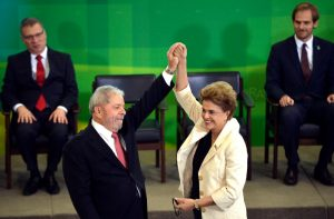 Former President Luiz Inácio Lula da Silva (L) with his successor Dilma Rousseff in March 2016. Wikimedia/Creative Commons, Agência Brasil/José Cruz.