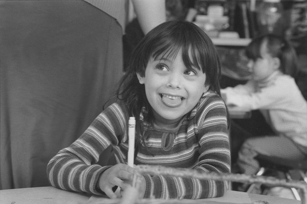 Grinning young girl hold a marker