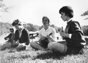 Women playing ukeleles, 1965