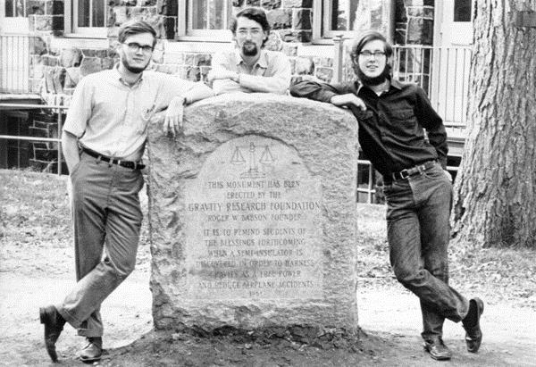 Bill Houston, Duncan LaBay, and Steve Buckingham standing around the monument erected by the Gravity Research Foundation, 1973.