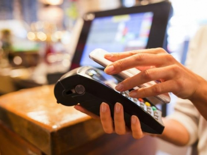 Person uses cell phone to complete payment at store