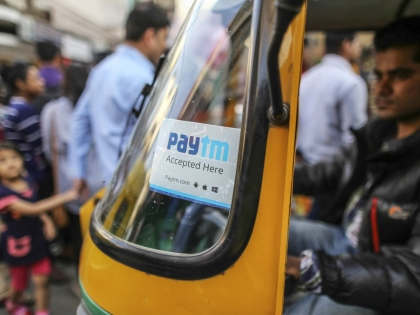 Tuk tuk in India has a sign for PayTM digital payments