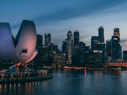 Singapore urban skyline at dusk.