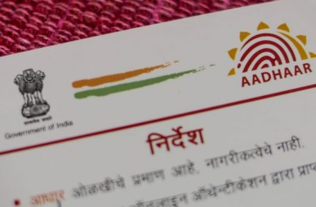 An Aadhaar biometric identity card, issued by the Unique Identification Authority of India (UIDAI), is arranged for a photograph in Mumbai, India, on Saturday, Jan. 28, 2017. India's Finance Ministry will recommend bold tax reform to ensure that Prime Minister Narendra Modi's growth-crimping cash ban wasn't in vain, people familiar with the matter said. Photographer: Dhiraj Singh/Bloomberg via Getty Images
