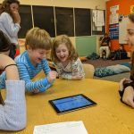 Professor Marina Bers observes the interactions between our children, her CD-145 students, and the technology learning tool, Scratch Jr.