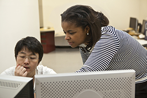 Dr. Valencia Joyner Koomson with a student. Tufts University Photo