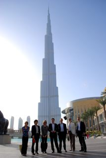 Yuki Ide, Atsushi Tanizawa, Anne Apuzzo, Jun Tazawa, Frank D'Agnese, Elli Tsiligianni, and Jordan Fabyanzke, in front of the Burj Khalifa, Dubai