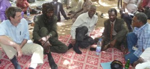 Pictured above are, from left to right, WPF executive director Alex de Waal, Suleiman Zakaria, Thabo Mbeki, Ali Haroun in Ain Siro, North Darfur, Sudan (July 2009).