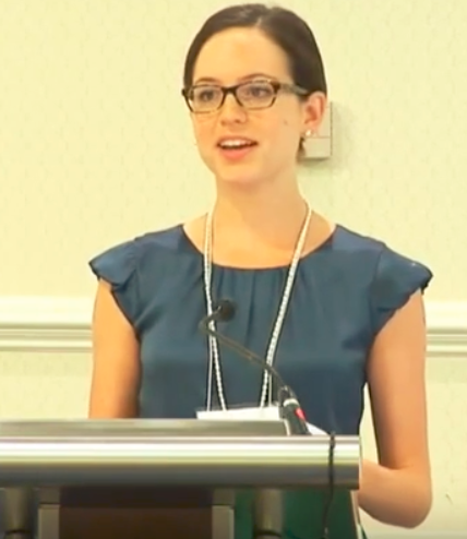 Rebecca speaking to the American Evaluation Association Conference