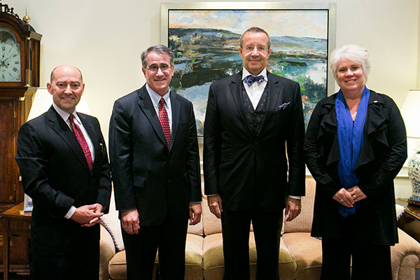 From left, Admiral James Stavridis, Dean of The Fletcher School; Tufts President Anthony P. Monaco; Estonian President Toomas Hendrik Ilves; and Estonian Ambassador to the United States Marina Kaljurand, F95, pose for a photo in Monaco's office on Sept. 25, 2013. (Kelvin Ma/Tufts University)