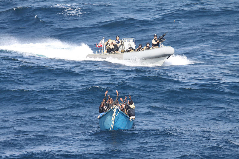 A visit, board, search and seizure team from the guided-missile destroyer USS Pinckney (DDG 91) approaches a suspected pirate vessel after the Motor Vessel Nordic Apollo reported being under attack and fired upon by pirates.  Photo: US Navy