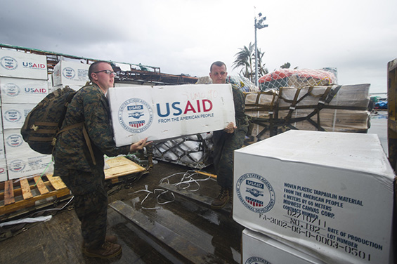 Hospital Corpsman 3rd Class Eric Chiarito, from Hyde Park, N.Y., left, and Marine Sgt. Jonathan Thornton, from Lake Havasu, Ariz., load supplies onto a forklift at Tacloban Air Base in support of Operation Damayan. The George Washington Strike Group supports the 3rd Marine Expeditionary Brigade to assist the Philippine government in response to the aftermath of Super Typhoon Haiyan/Yolanda in the Republic of the Philippines. (U.S. Navy photo by Mass Communication Specialist 3rd Class Ricardo R. Guzman/RELEASED)  Date Taken:11.14.2013