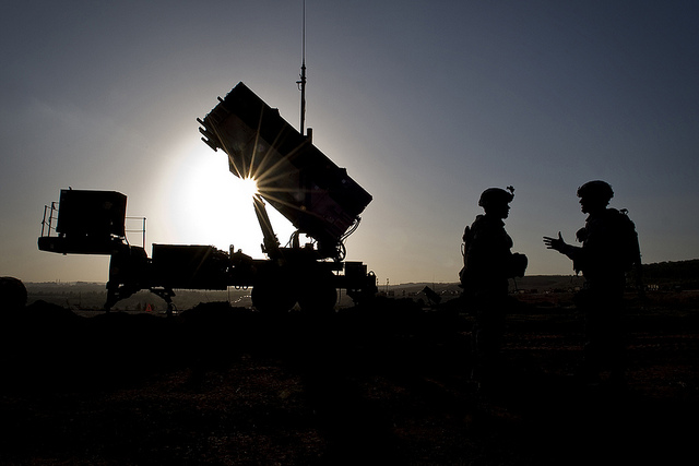 U.S. Soldiers with the 3rd Battalion, 2nd Air Defense Artillery Regiment talk after a routine inspection of a Patriot missile battery at a Turkish military base in Gaziantep, Turkey. U.S. and NATO Patriot missile batteries and personnel deployed to Turkey in support of NATO's commitment to defending Turkey's security during a period of regional instability. (DoD photo by Master Sgt. Sean M. Worrell, U.S. Air Force/Released)
