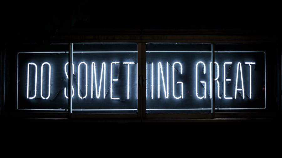 """Neon sign that says """"Do Something Great"""""""