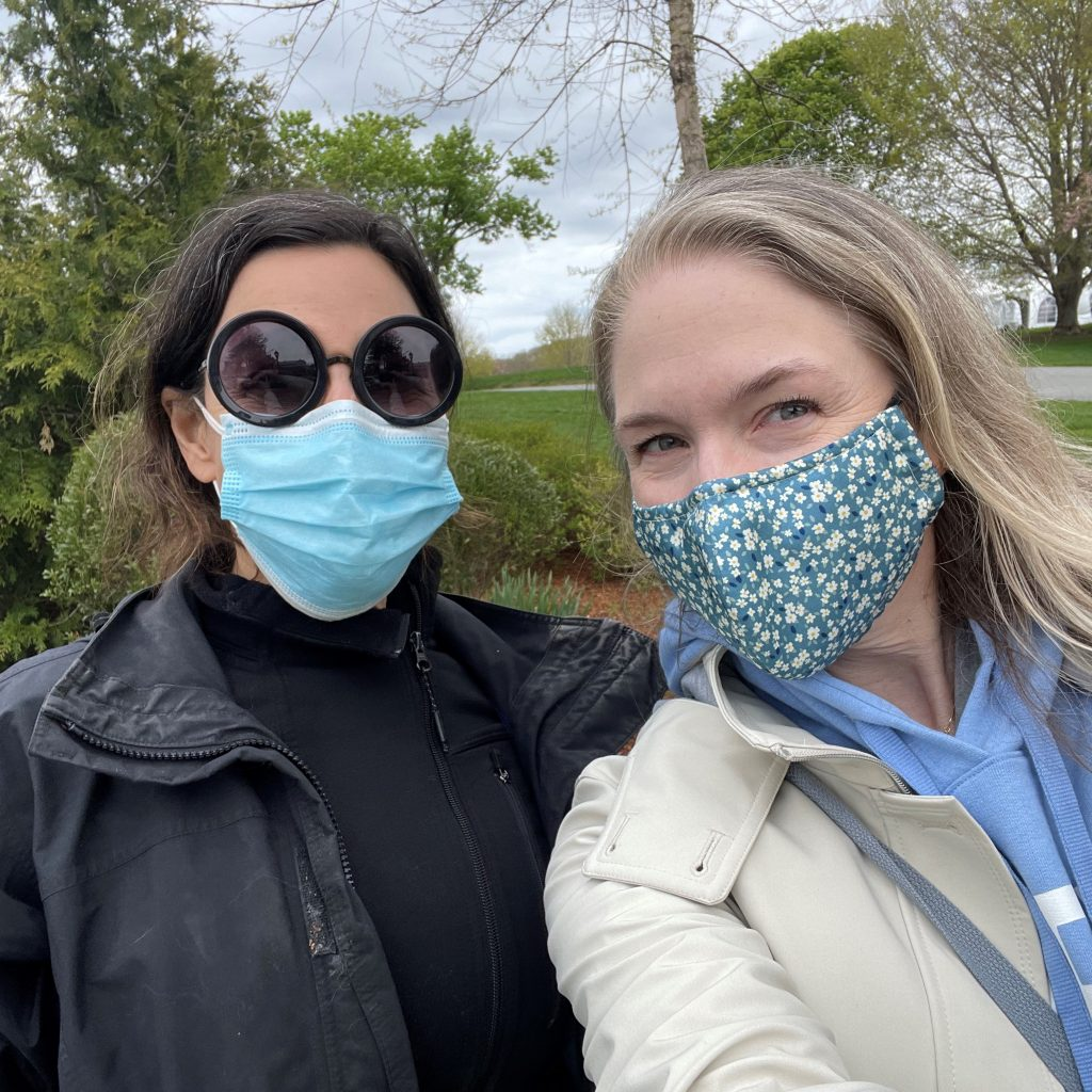 Sarah W. and Elise Z. standing side by side in a selfie photo wearing face masks.