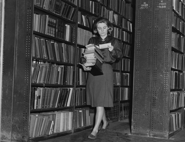 """Collecting books for readers in the reserve stacks, 1964."" LSE Library. https://www.flickr.com/photos/lselibrary/3925726691/"