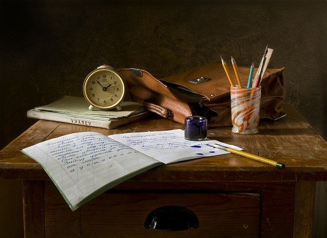 Image of papers and writing supplies on a table