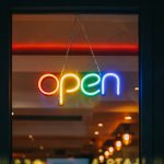 """A neon sign saying """"open"""""""