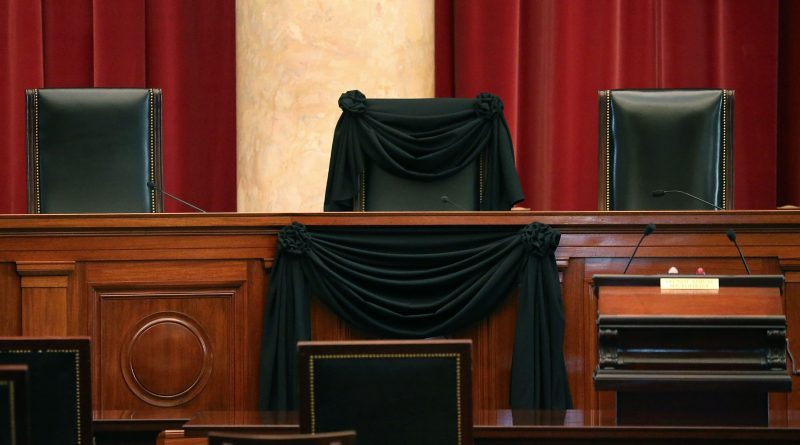 an empty supreme court seat once occupied by Ruth Bader Ginsburg