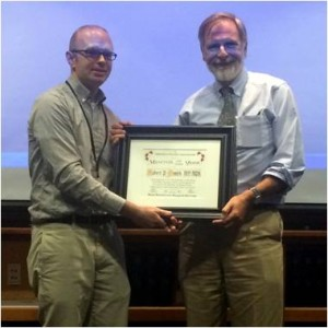 Former RFA president Dave Kuhrt, PhD presenting the 2014 Mentor of the year certificate to Dr. Rob Smith