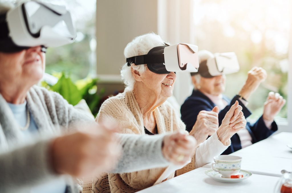 senior citizens using VR headsets