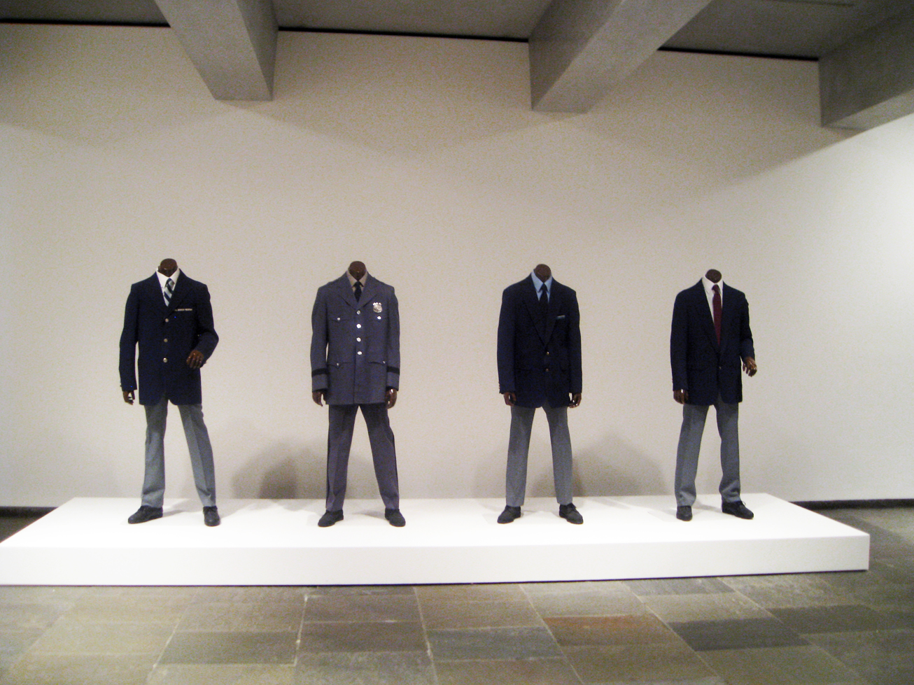 Black headless mannequins dressed as museum guards, from Fred Wilson's Guarded View. Image from Arts Observer.