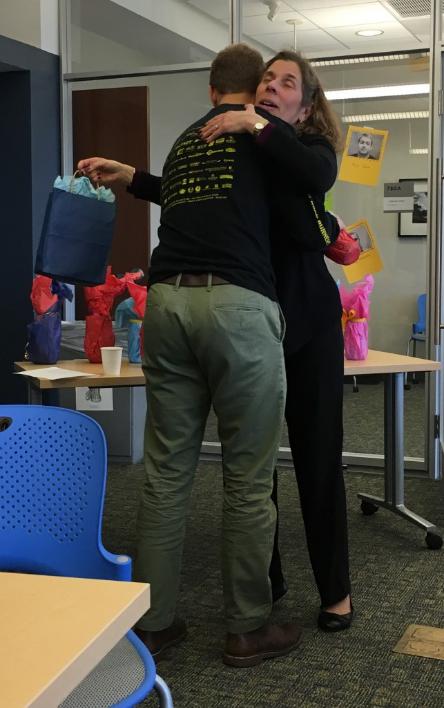 The director hugs the tutor