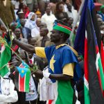 A man dressed in the Southern Sudanese colors and flag parades at the John Garang Mausoleum during the celebrations of independence day in the city of Juba, the capital of the newly created state of South Sudan.