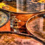 close up of 4 rusty orange oil barrels