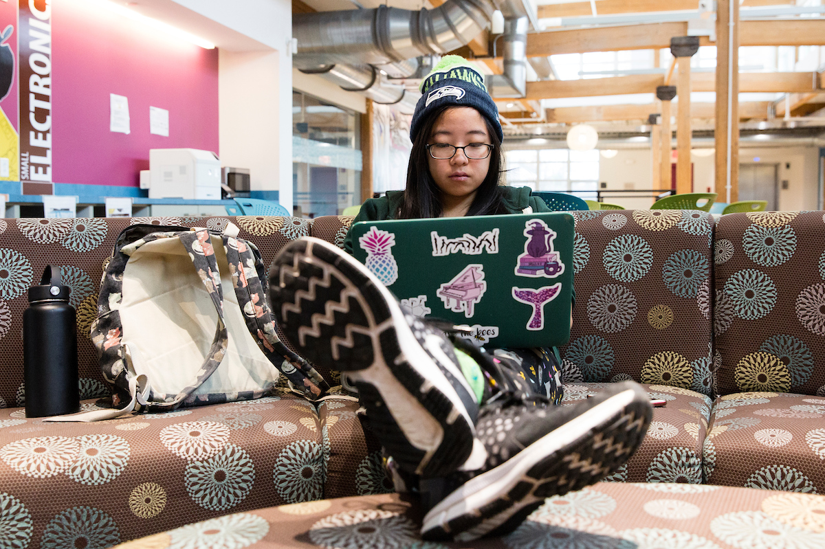 A Tufts student studies for final exams in the Collaborative Learning and Innovation Complex, December 2017 (Anna Miller/Tufts University)