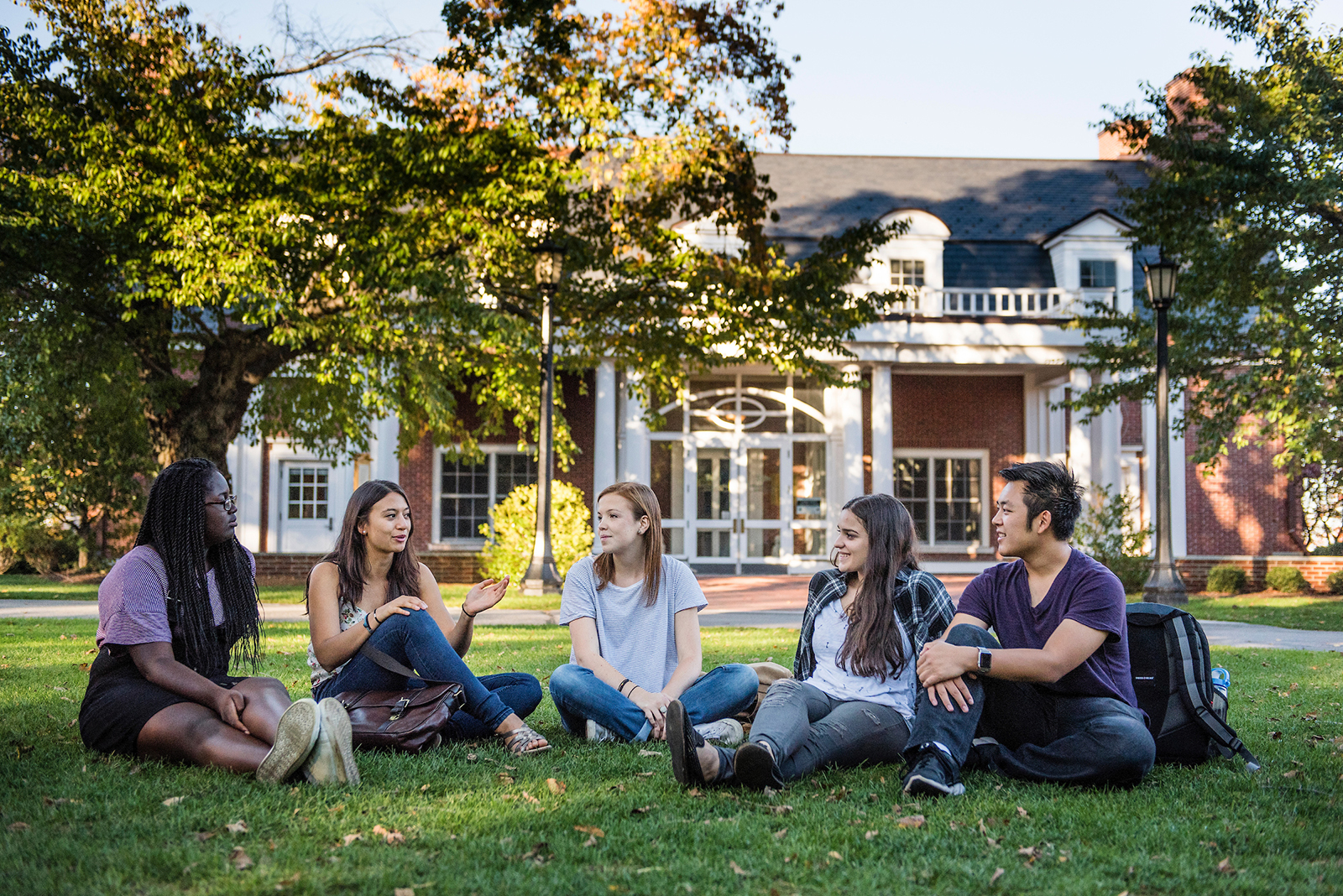 Undergraduate students pose for photos in front of Bendetson Hall on the Medford/Somerville Campus on October 12, 2015. (Alonso Nichols/Tufts University)