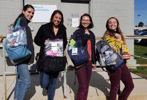 interns with zero waste week bags