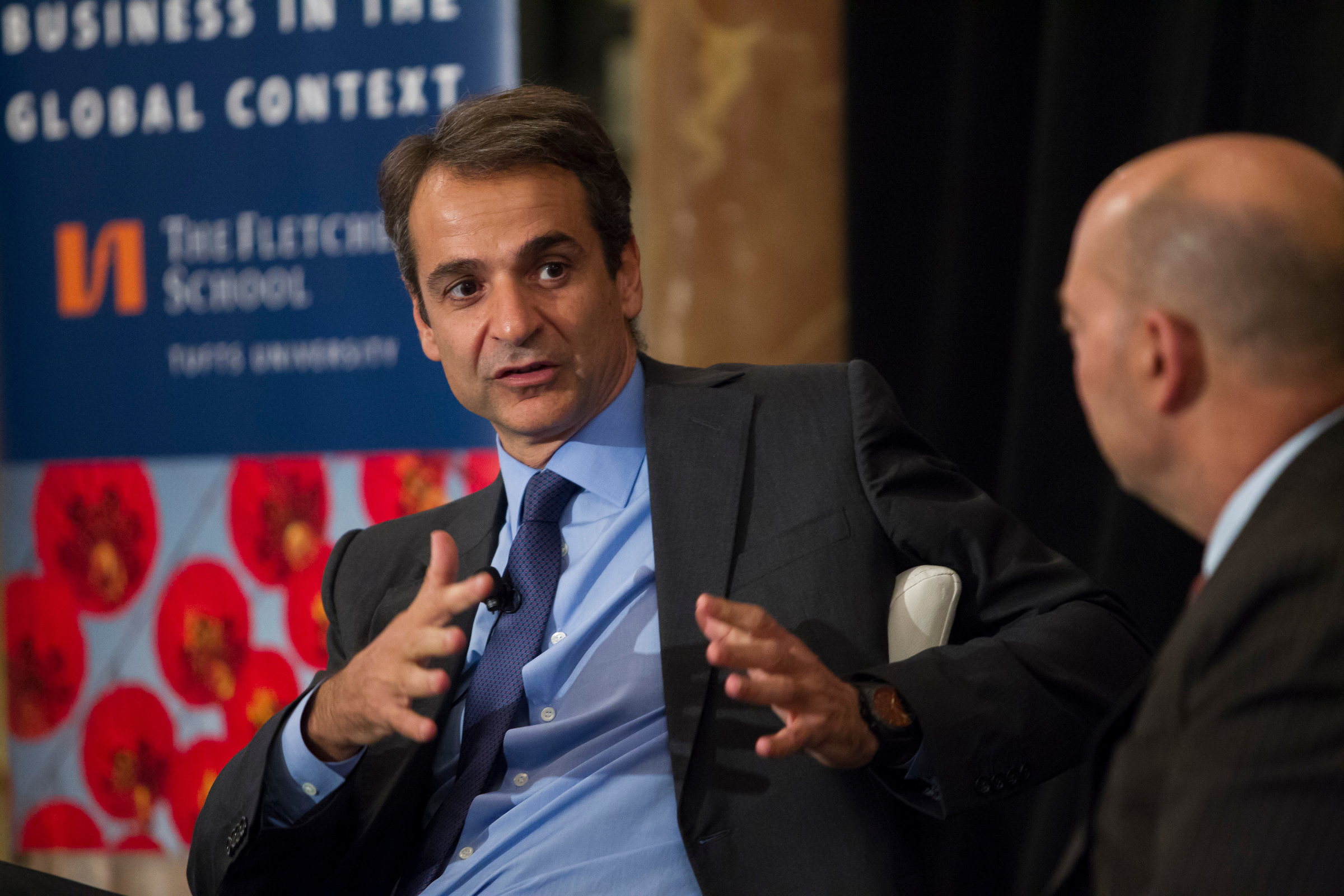 """10/13/2016 - Boston, Mass. - James Stavridis, Dean of The Fletcher School at Tufts University (R) chats with Kyriakos Mitsotakis, President, New Democracy during the """"Greece's Turn? Litmus Test for Europe""""  conference inside the Fairmont Copley Plaza in Boston. The conference is being hosted by The Fletcher School. (Matthew Healey for Tufts University)"""