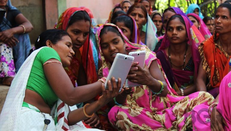 Group of women use tablet