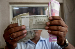 Love of cash hinders India's move to digital economy, Reuters
